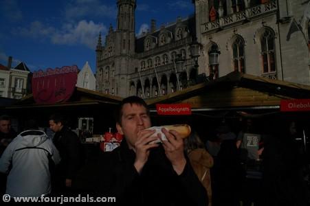 Enjoying a Bratwurst at the Bruges Christmas Markets